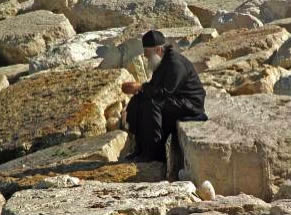 monk_praying_among_rocks