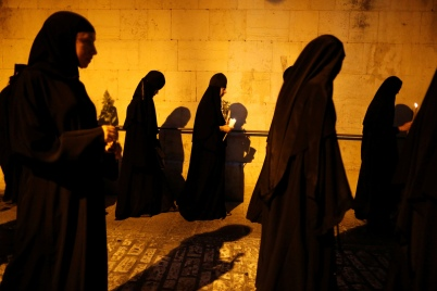 Orthodox Christian nuns take part in an annual procession along the Via Dolorosa in Jerusalem's Old City